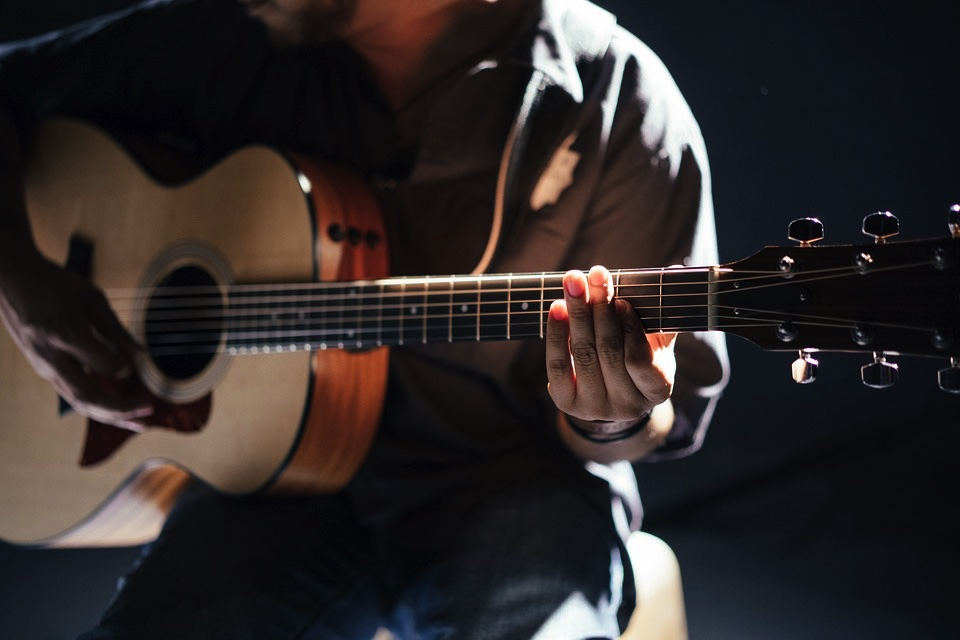 thin body acoustic guitars are easier to learn on